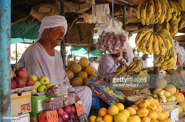 Sudanese man sells fruit at a market in Shendi the hometown of President Omar alBashir located on the banks of the Nile in Sudan's Arab heartland 190...