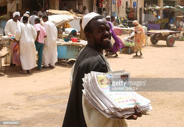 Sudanese man sells newspapers at a market in Shendi the hometown of Sudanese President Omar alBashir located on the banks of the Nile in Sudan's Arab...