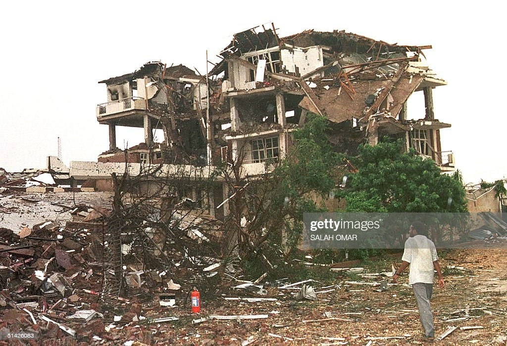 Sudanese man stands next to the alShifaa pharmaceutical plant in Khartoum north 21 August after it was destroyed the previous day by US military...