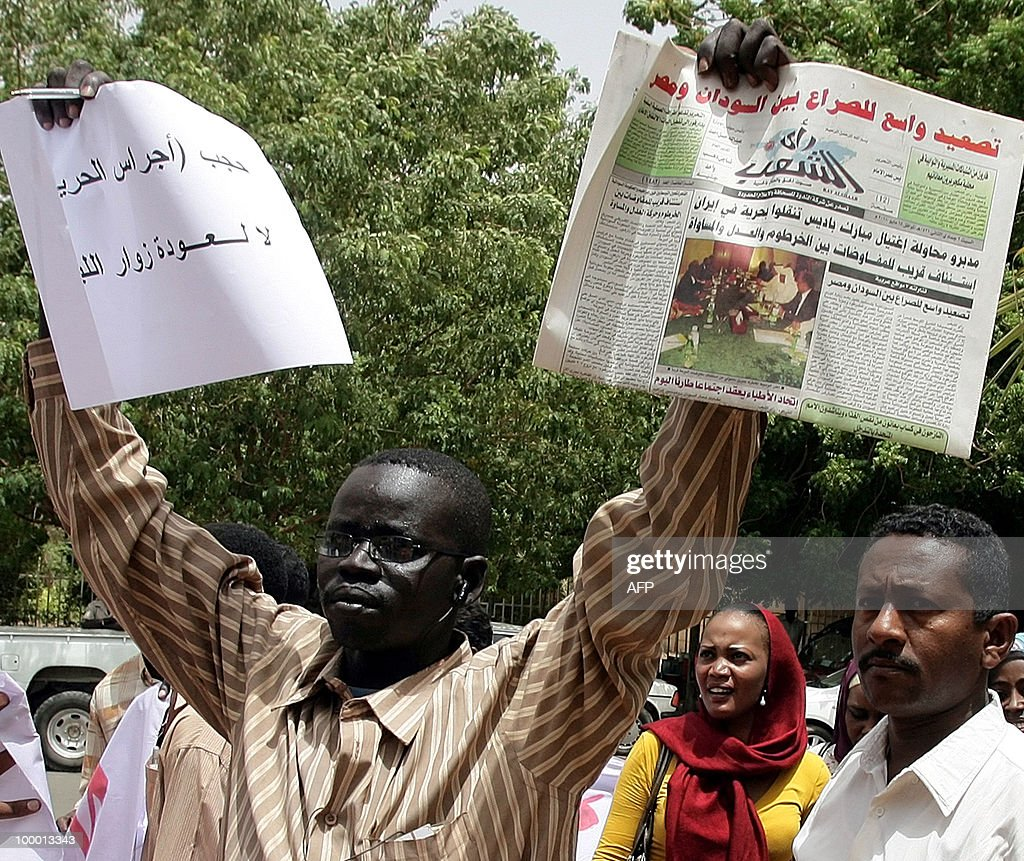 A Sudanese man takes part in a protest against the storming by security forces of two newspaper offices in the capital Khartoum on May 20, 2010. Sudanese security officers stormed two newspapers yesterday tearing up articles ready for printing, employees said, despite a 2009 presidential decree promising to lift press censorship. Authorities went to the offices of the Ajras al-Hurriya, which is linked to the former southern rebel Sudan People's Liberation Movement and the independent daily Al-Sahafa, and confiscated articles. Sudan boasts around 30 titles in both English and Arabic published daily to represent all persuasions -- pro-government, Islamist or communist -- and showcase the country's multi-faceted political make-up.