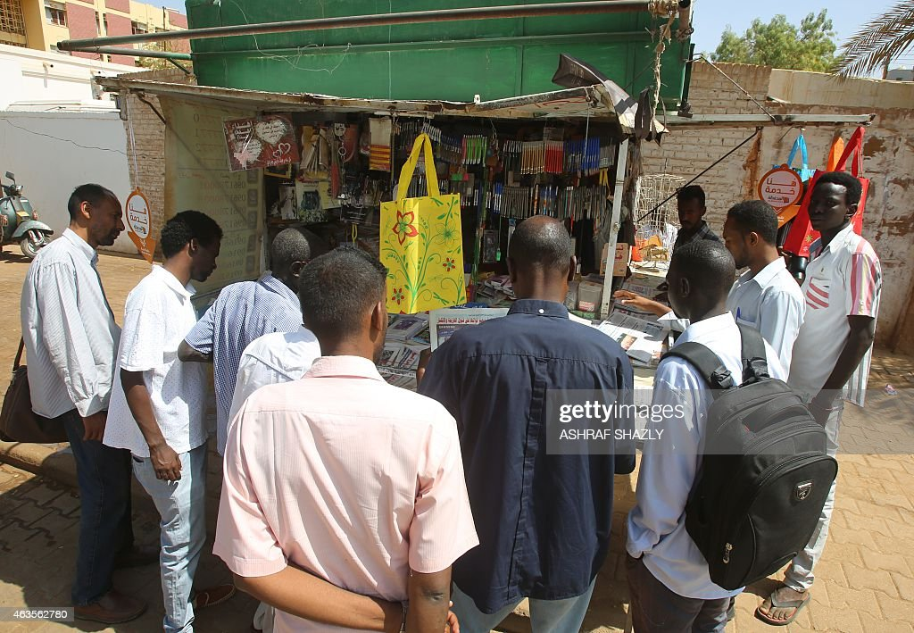 Sudanese men look at newspapers displayed at a kiosk in the capital Khartoum on February 16 2015 Sudanese security officers seized the print runs of...
