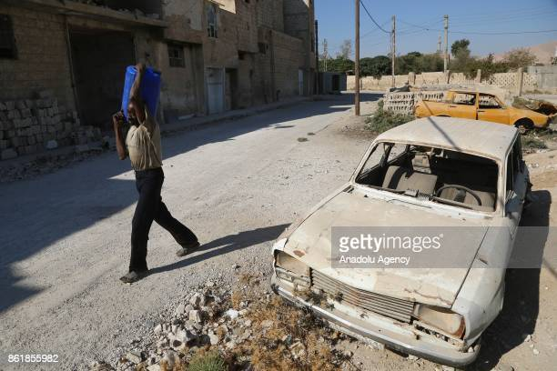 Sudanese Mirsal Ali is seen outside of his oneroomed flat in Eastern Ghouta district of Damascus Syria on September 20 2017 Mirsal Ali hopes to...
