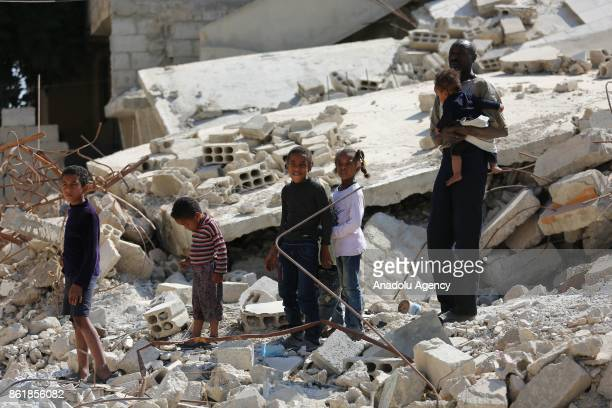 Sudanese Mirsal Ali is seen with his children outside of his oneroomed flat in Eastern Ghouta district of Damascus Syria on September 20 2017 Mirsal...