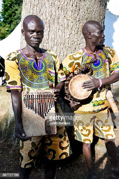 Sudanese musicians Gaetano Otira Tep Yer Yer and Kornelio Odong Mulili of Acholi Machon with a thumb piano or likembe at the Womad festival at...