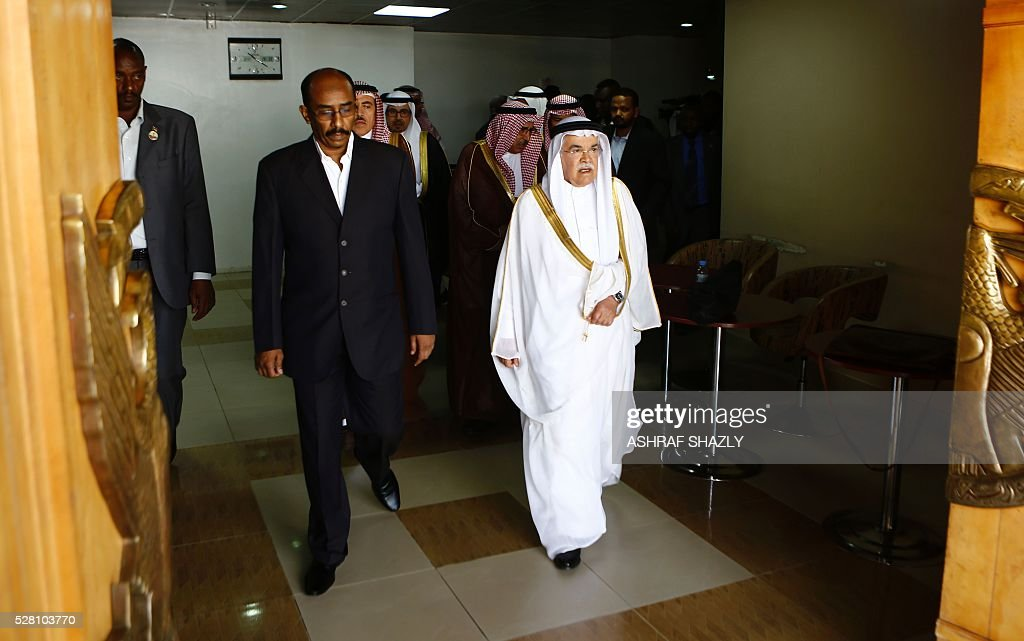 Sudanese Oil Minister Ahmed Mohamed al-Karuri (L) and Saudi Oil Minister Ali al-Naimi (R) arrive for a press conference following a meeting in Khartoum on May 4, 2016. Al-Naimi arrived in Khartoum for a one-day visit aimed at stepping up Riyadh's investments in its new east African ally Sudan. Sudan has moved closer to Saudi Arabia in recent months after severing relations with Shiite Iran, in a bid to attract investments to boost its dilapidated economy. SHAZLY