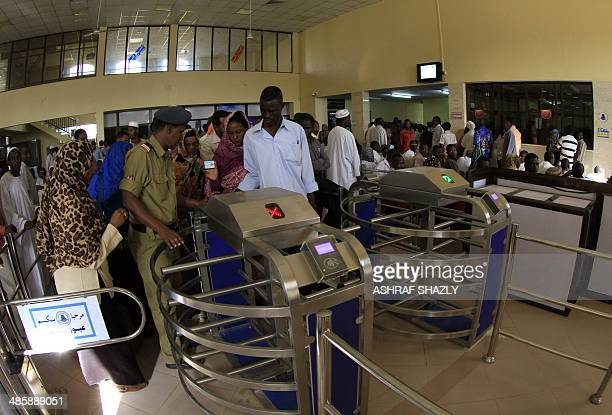 Sudanese passengers pass through the gates on the platform of Sudan's new Nile Train in Khartoum on March 17 2014 In a dilapidated povertystricken...