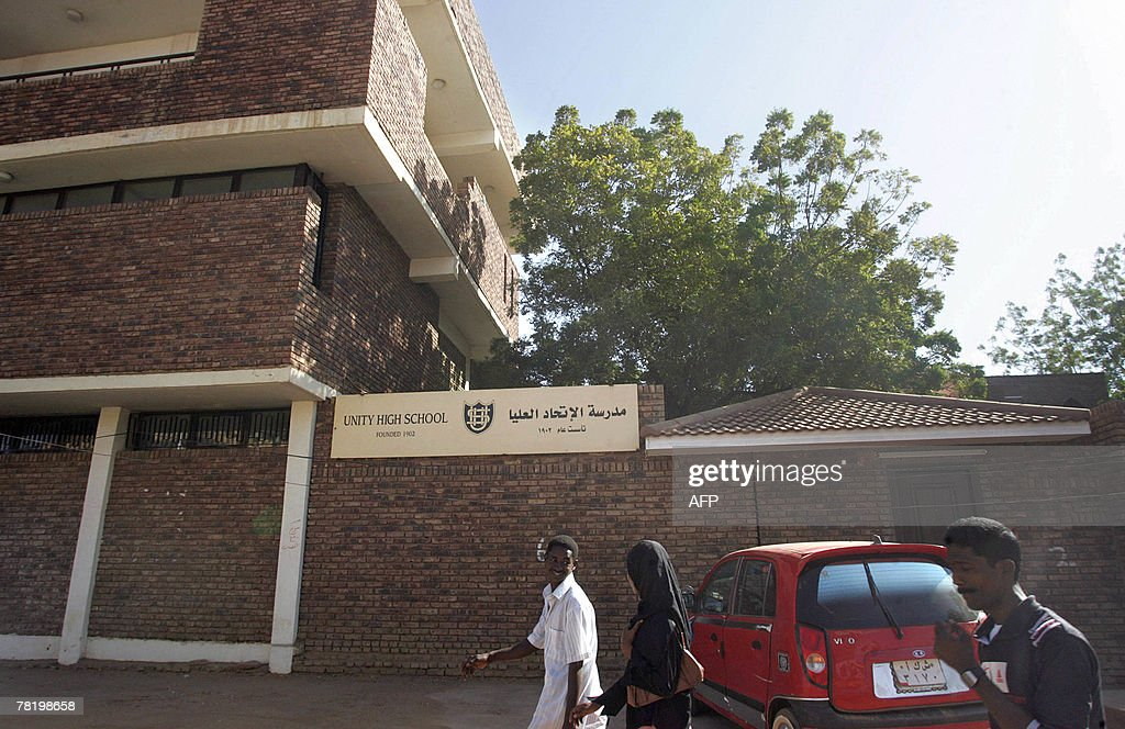 Sudanese people walk past Unity High School in central Khartoum 01 December 2007 The United States said yesterday that Sudan overreacted in jailing a...