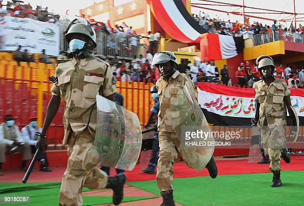 Sudanese policemen deploy in the football field ahead of the 2010 World Cup qualification playoff between Egypt and Algeria in Khartoum on November...
