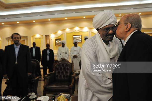 Sudanese President Al Bashir greets Iranian Speaker of parliment Ali Larijani along with a high level delegation of Arab and Iranians including Hamas...