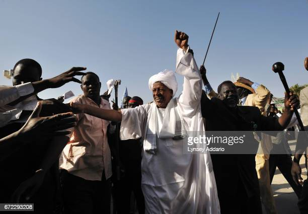 Sudanese President Al'Bashir greets Southern Sudanese villagers and dignitaries at a rally in celebration of President Bashir in Khartoum Sudan March...