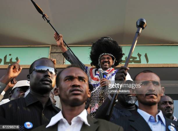 Sudanese President Bashir dances and celebrates with Southern Sudanese villagers and dignitaries at a rally in Khartoum Sudan March 7 2009 Bashir...