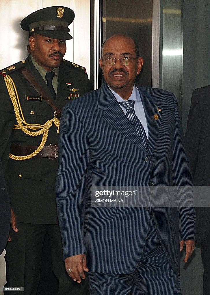 Sudanese President Omar Al Bashir (R) arrives on January, 25, 2013 to attend closed-door talks in Adis Ababa. Sudanese President Omar al-Bashir and his Southern counterpart Salva Kiir met at the African Union-mediated talks for the second time this month to push deals signed in September after bloody border conflict broke out last year.