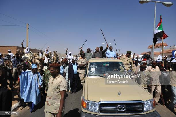 Sudanese President Omar Al Bashir parades through the streets of El Fasher in North Darfur before holding a rally in El Fasher Sudan March 8 2009...