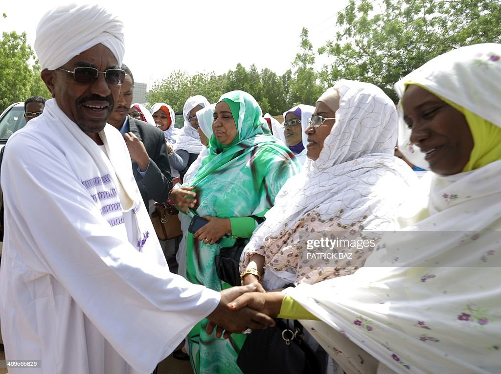 Sudanese President Omar al-Bashir (L) and candidate in the presidential elections greets supporters as he arrives at a polling station to cast his vote at the Saint Francis school in Khartoum on April 13, 2015. With 15 little-known candidates running against him, 71-year-old Bashir faces no real competition in the second contested vote since he seized power in 1989. AFP PHOTO / PATRICK BAZ