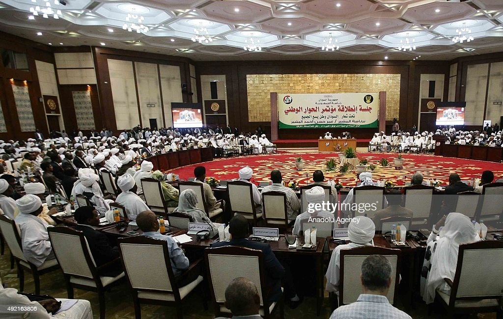 Sudanese President Omar alBashir and Chadian President Idriss Deby arrive to attend the national dialogue conference in Khartoum Sudan on October 10...