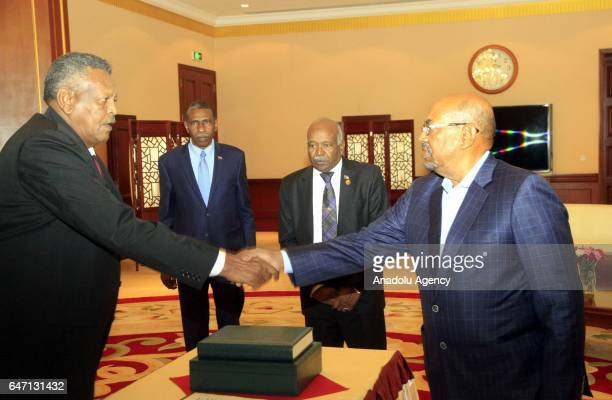 Sudanese President Omar alBashir and newly appointed Sudanese Prime Minister Bakri Hassan Saleh shake hands during his oathtaking ceremony in...