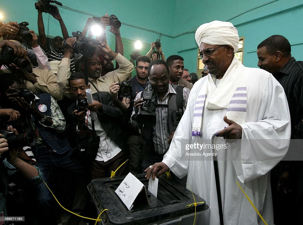 Sudanese President Omar al-Bashir casts his ballot in the presidential and parliamentary elections at a polling station in Khartoum, Sudan on April 13, 2015.