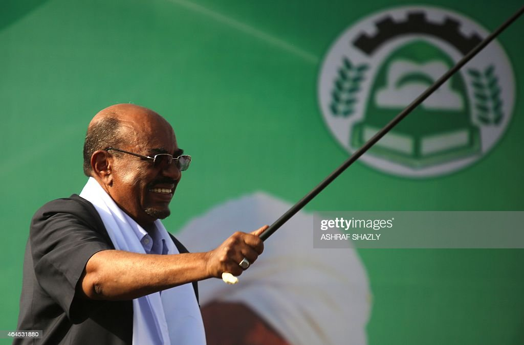 Sudanese President Omar al-Bashir (C) gestures to supporters after delivering a speech during an election campaign rally in Wad Madani, the capital of Sudan's east-central al-Jazirah state on February 26, 2015 ahead of the April 13 elections. The National Electoral Commission has said some 14 candidates are competing with Bashir for the presidency but most are little-known and pose no real threat to his reelection bid. AFP PHOTO / ASHRAF SHAZLY