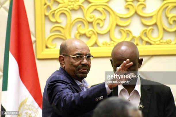 Sudanese President Omar alBashir greets people following a press conference at Presidential Mansion in Khartoum Sudan on March 02 2017