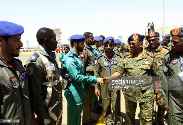 Sudanese President Omar alBashir greets soldiers during the joint Sudan and Saudi Arabia air force drill at the Marwa air base which is 350 km south...