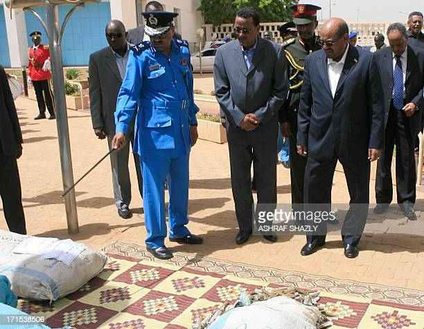 Sudanese President Omar alBashir is shown bags containing drugs as nations mark the International Day Against Drug Abuse and Illicit Trafficking in...