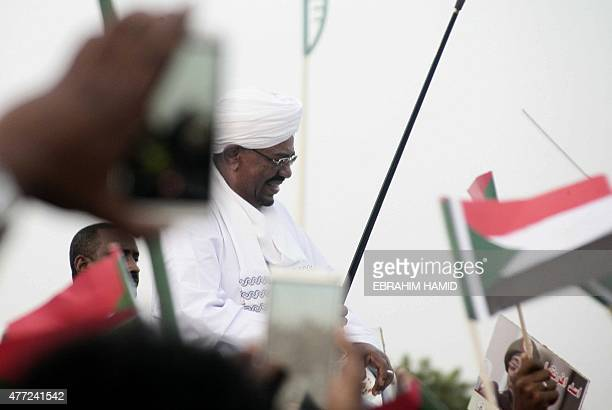 Sudanese President Omar alBashir is welcomed by supporters arrives in Khartoum from Johannesburg on June 15 2015 after a court ordered him not to...