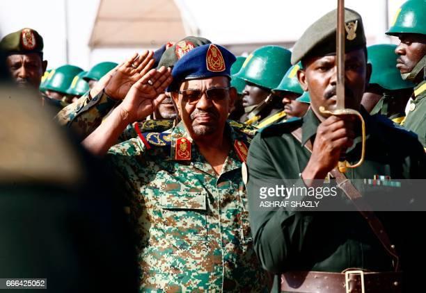 Sudanese President Omar alBashir salutes during the joint Sudan and Saudi Arabia air force drill at the Marwa air base near Meroe some 350 kilometres...