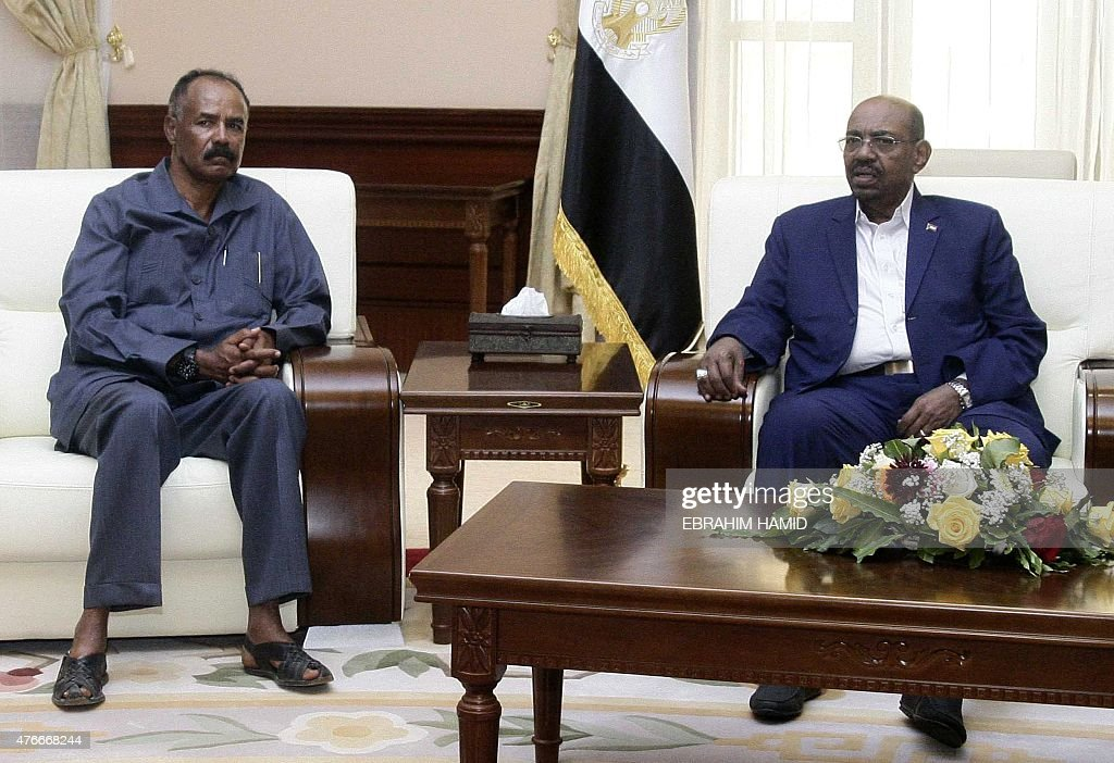 Sudanese President Omar alBashir sits with his Eritrean counterpart Isaias Afwerki during a meeting following the latter's arrival in SUdan's capital...
