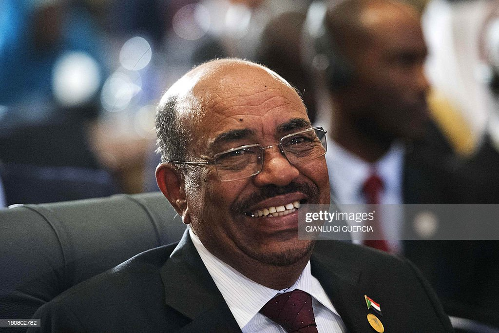 Sudanese President Omar al-Bashir smiles as he attends the 12th summit of the Organisation of Islamic Cooperation on February 6, 2013 in Cairo. The 12th summit of the Organisation of Islamic Cooperation opened in Cairo, with Syria's civil war and the battle against Islamist militants in Mali topping the agenda. The meeting gathers the leaders of 26 of the OIC's 57 states, including the presidents of Iran and Turkey.