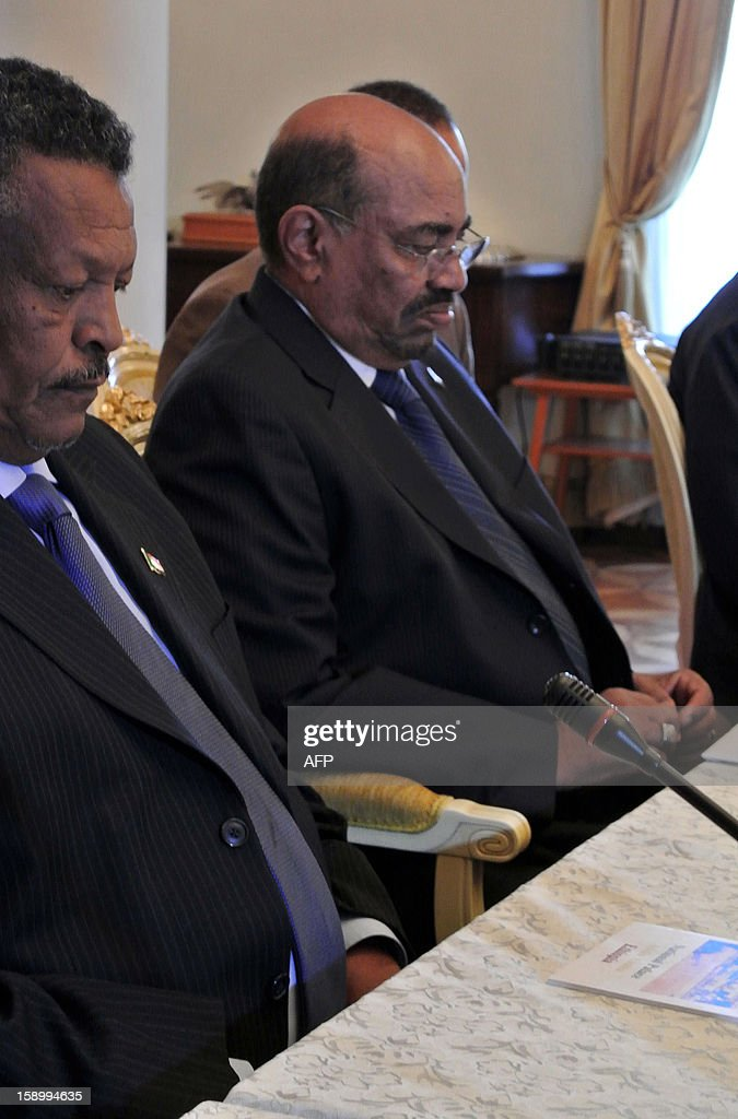 Sudanese President Omar al-Bashir (C) waits ahead of a Presidential summit with his South Sudanese counterpart, in Addis Ababa on January 5, 2013. The rival presidents of Sudan and South Sudan met for face-to-face talks on January 5 to push forward stalled security, oil and border deals, and to discuss the fate of the contested Abyei region. Sudanese President Omar al-Bashir and his Southern counterpart Salva Kiir met alongside African Union mediator Thabo Mbeki, while tensions remain high after the latest in a string of accusations that Khartoum had bombed South Sudan. Ethiopian Prime Minister Hailemariam Desalegn, who is hosting the talks, also attended the first meeting between the former civil war foes for over three months, when they signed a raft of key deals that have yet to be implemented.