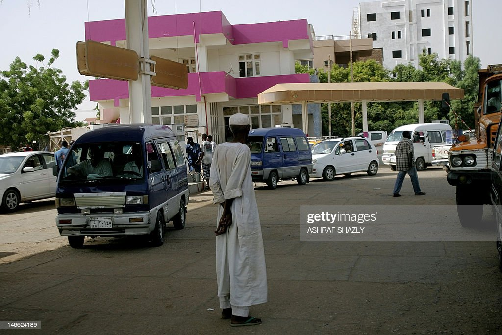 Sudanese queue in a petrol station to fuel their vehicles in the capital Khartoum on June 21 2012 Sudan announced details of planned austerity...