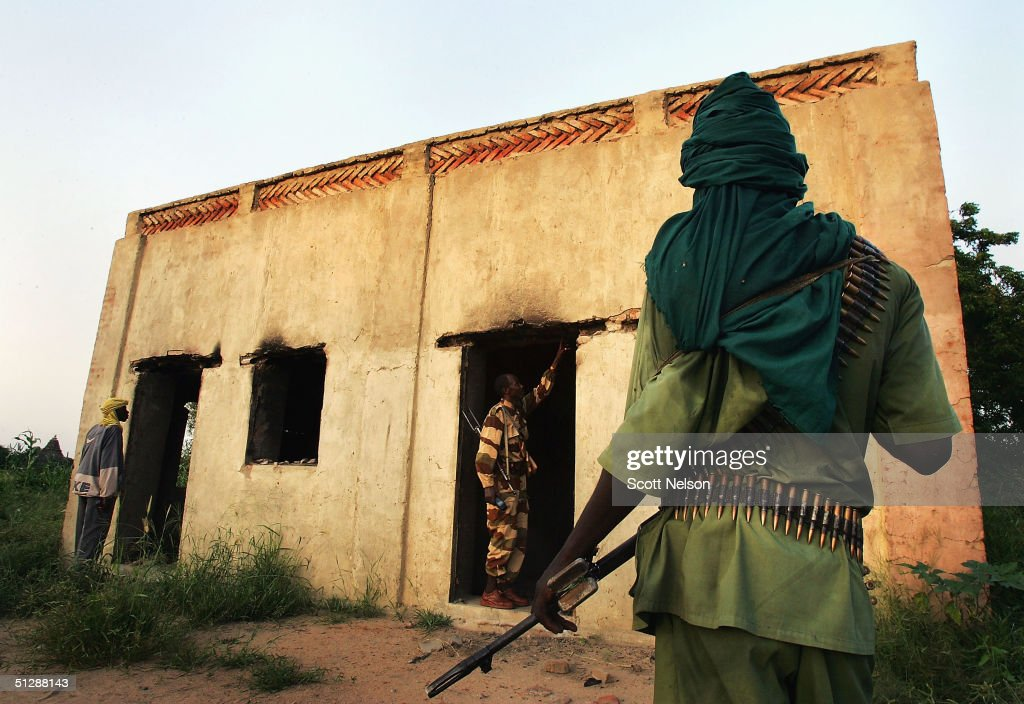 Sudanese rebel from the Justice and Equality Movement investigates the scene in Ulang a village recently burned by Janjaweed militiamen in the...