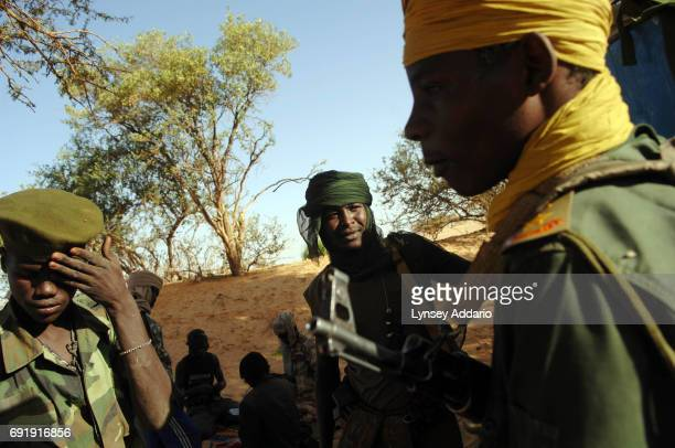 Sudanese rebels with the NRF hang out at dawn near Kariari somewhere between Chad and the Darfur border where dozens of rebels come to relax repair...