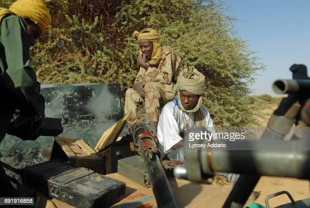 Sudanese rebels with the NRF show off the weapons and trucks they took from the Sudsnese Government soldiers during a recent attack on the government...