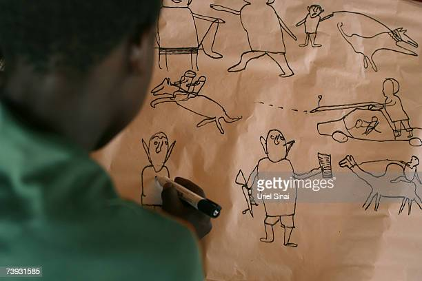 A Sudanese refugee child draws pictures as part of a project by HIAS in Goz Amir Refugee Camp on April 2007 near the border with Sudan in Chad HIAS...