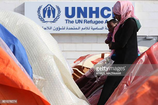 A Sudanese refugee from Darfur walks past tents during an openended sitin outside the United Nations High Commissioner for Refugees in the Jordanian...