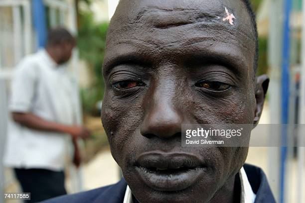 Sudanese refugee Reath Choul waits to board a bus as he leaves a shelter with his family for promised accomodation and employment May 10 2007 in...