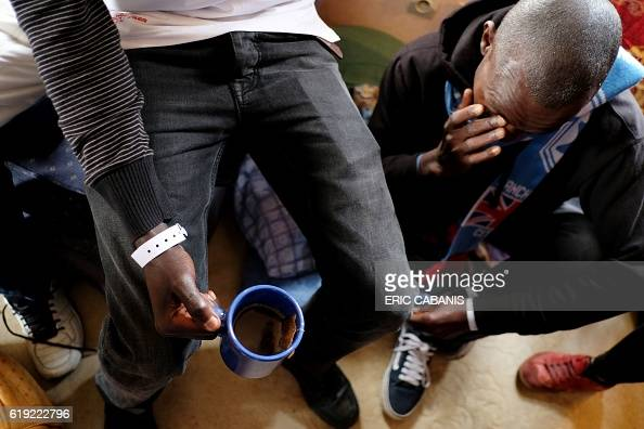 Sudanese refugee wears a plastic bracelet indicating a bus number in the 'Centre dAccueil et dOrientation pour migrants' in Bruniquel near Montauban...