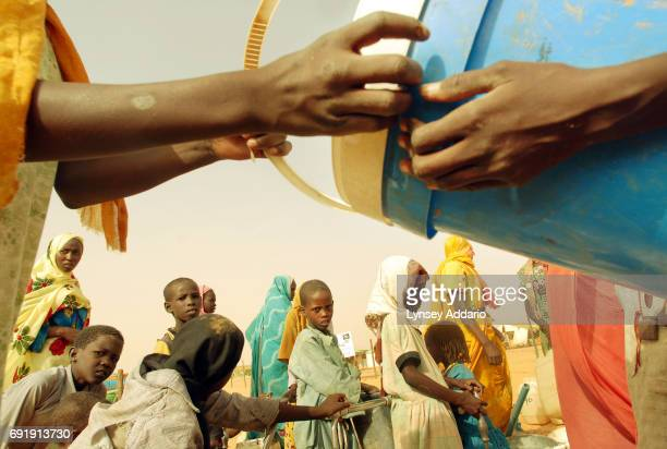Sudanese refugees gather at a water point in Bahai camp in northeastern Chad October 17 2006 Chad with its very limited supply of natural resources...