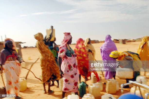 Sudanese refugees gather at a water point in Touloum camp in northeastern Chad October 15 2006 Chad with its very limited supply of natural resources...