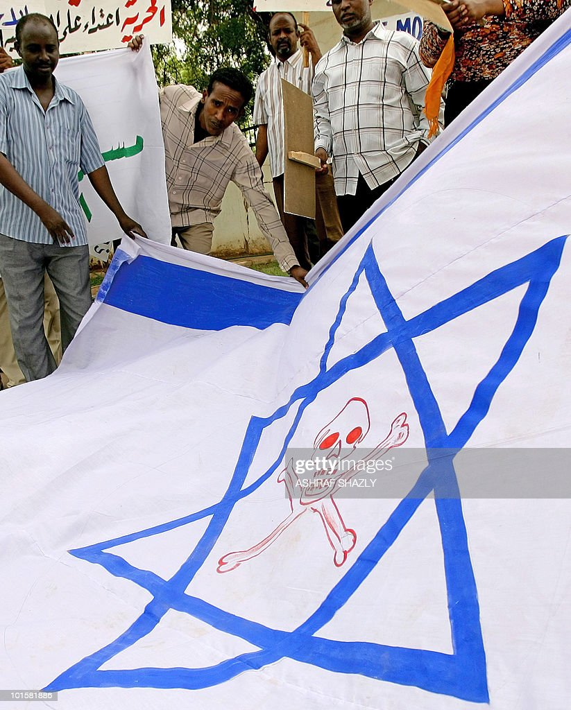 Sudanese show the Israeli flag before burning it in the capital Khartoum during a protest on June 3, 2010, against the deadly storming of one of six aid ships by the Israeli commandos as the flotilla sailed in international waters in the Mediterranean Sea towards the Palestinian Gaza Strip carrying humanitarian aid.