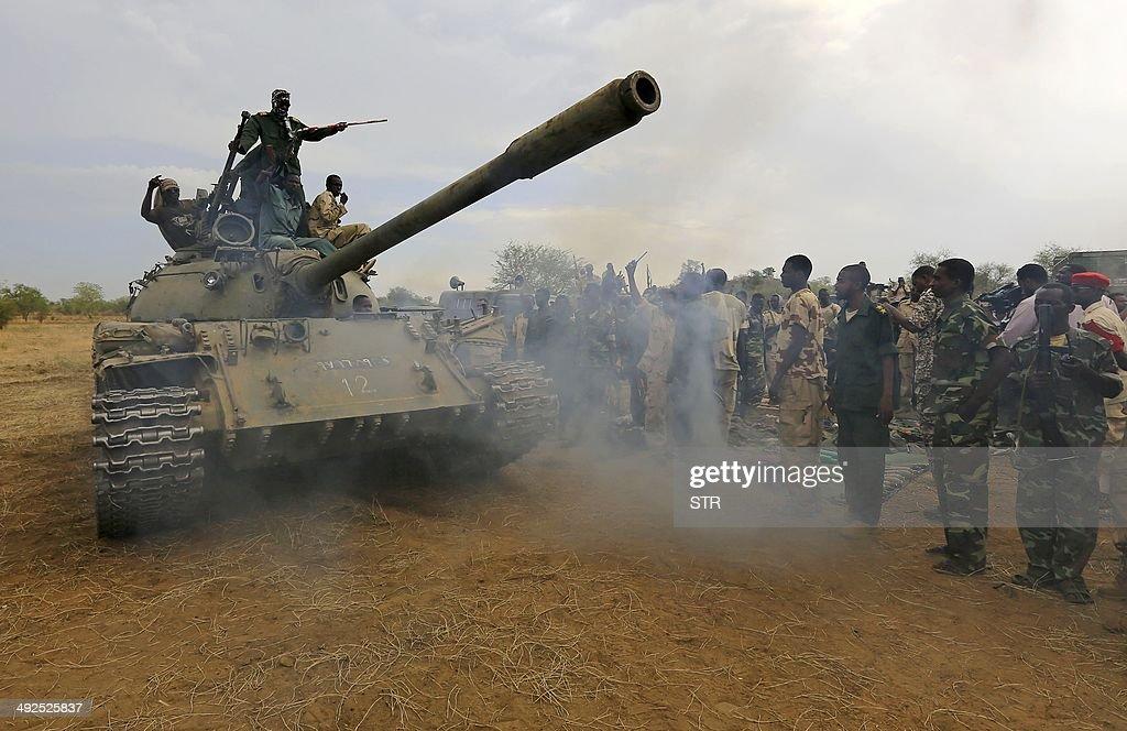 Sudanese soldiers celebrate on a tank after recapturing the Daldako area about 20 kilometres northeast of South Kordofan's state capital Kadugli on...