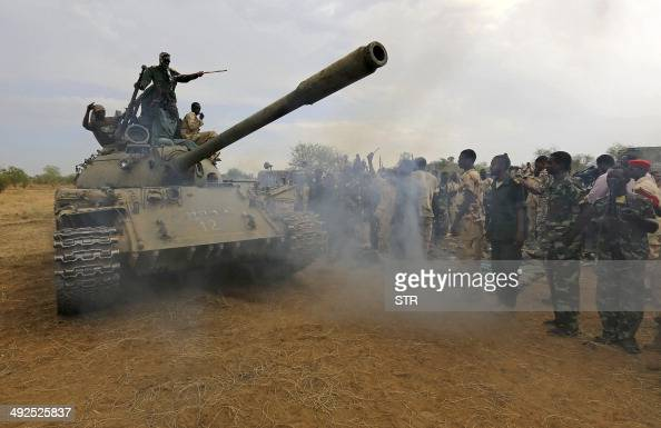 Sudanese soldiers celebrate on a tank after recapturing the Daldako area about 20 kilometres northeast of South Kordofan's state capital Kadugli on...