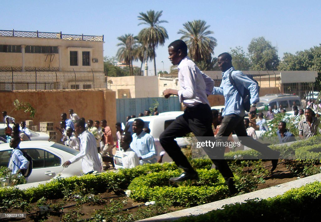 Sudanese students run during a demonstration in the capital Khartoum on December 9, 2012, as they rallied in support of four dead students originally from the conflict-plagued Darfur region, witnesses said. The death of the four has prompted a re-emergence of Arab Spring-inspired calls for the downfall of the government. AFP PHOTO/STR
