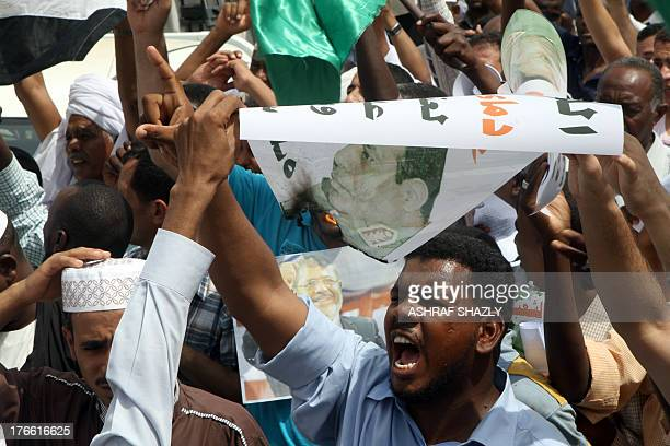 Sudanese supporters of the Muslim Brotherhood and Egypt's ousted president Mohamed Morsi protest following Friday noon prayers in front of the...