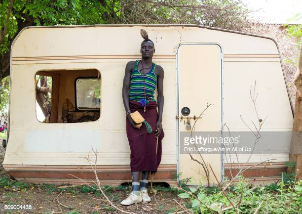 Sudanese Toposa tribe man refugee in front of an old abandonned caravan Omo Valley Kangate Ethiopia on June 9 2017 in Kangate Ethiopia
