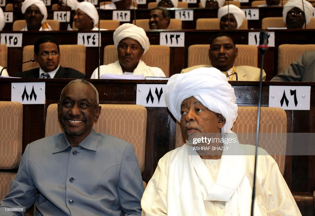 Sudanese vice-president Ali Osman Taha (L) sits next to MP Ahmed Abdel Rahman Mohammed during the first session of the new parliament in Khartoum on May 24, 2010. Sudan's new parliament met for the first time since the April legislative elections and elected a speaker. The elections, the first multi-party polls in the war-ravaged country since 1986, were replete with technical problems, fraud charges and opposition boycotts according to the US-based Carter Centre that monitored the polls.