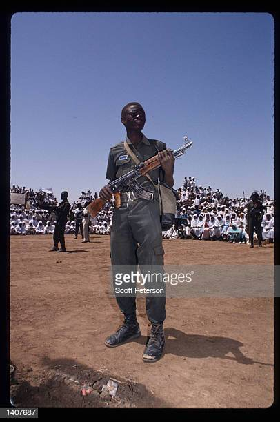 Sudanese warriors participate in a rally for President Omar Hassan elBashir February 28 1992 in Ed Daein Sudan Upon his return from a development...