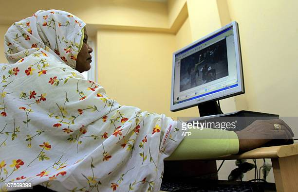 A Sudanese woman browses the internet at an office in Khartoum on December 14 2010 as the authorities arrested about 30 women who tried to hold a...