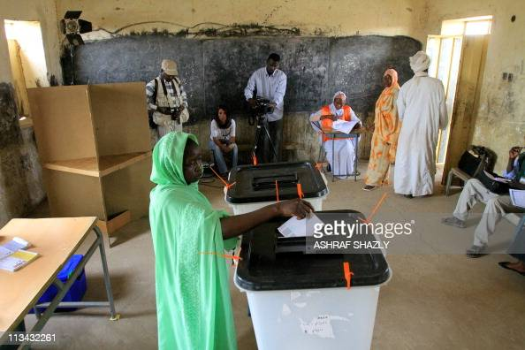 A Sudanese woman casts he ballot at a polling station during the election for governor and regional assembly for the Sudanese oilproducing northern...
